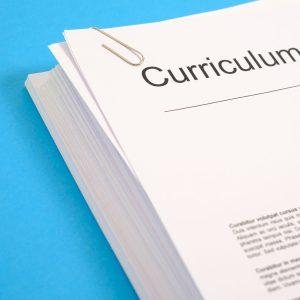 A pile of printed CVs