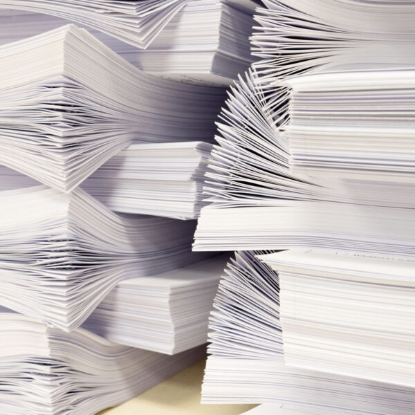 A stack of printed and stapled sheets of paper