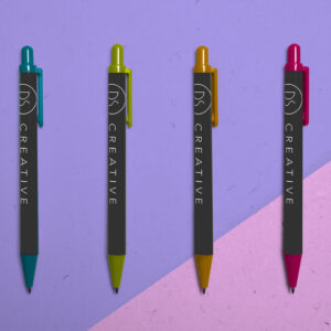 an image depicting 4 simple ballpoint pens on an abstract background. The pens are customised to have DS Creative's logo on them.